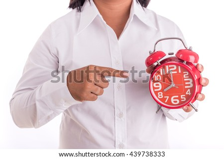 Woman holding red alarm clock isolated on white background - stock photo