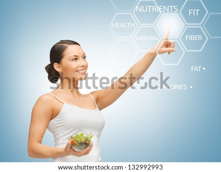 woman holding salad and working with virtual screen - stock photo