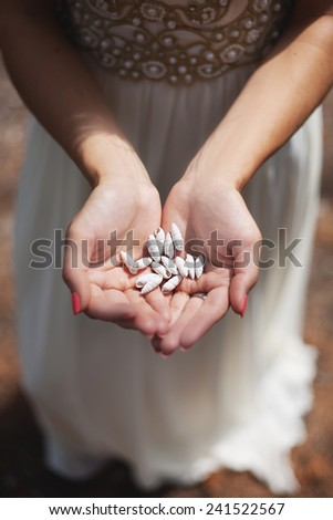 Woman holding shell in her hands - stock photo