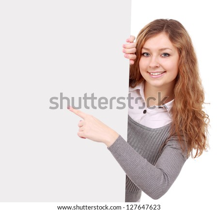 woman holding sign - Portrait of a beautiful woman holding a  blank billboard. - stock photo