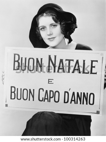 Woman holding sign written in Italian - stock photo