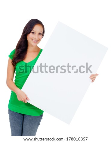 Woman holding signboard billboard smiling fresh. Beautiful playful casual Caucasian woman showing blank sign. Isolated on white background. - stock photo