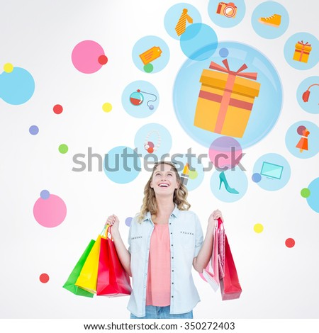 Woman holding some shopping bags against dot pattern - stock photo