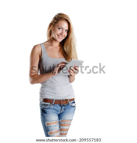 Woman holding tablet computer isolated on white background. working on touching screen. Casual smiling caucasianwoman. - stock photo