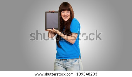 Woman Holding Tablet Isolated On Gray Background - stock photo