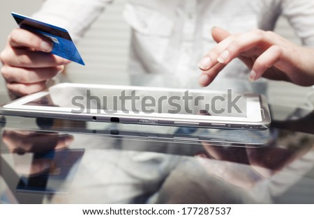 Woman holding tablet pc and credit card indoor, Shopping Online - stock photo