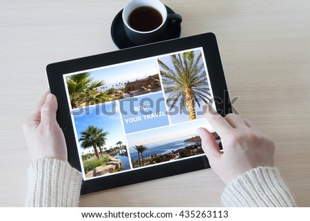 Woman holding tablet pc with pictures gallery, planning vacations, booking travel - stock photo