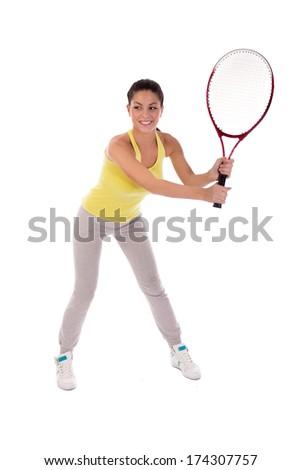 woman holding tennis racket, studio shot - stock photo