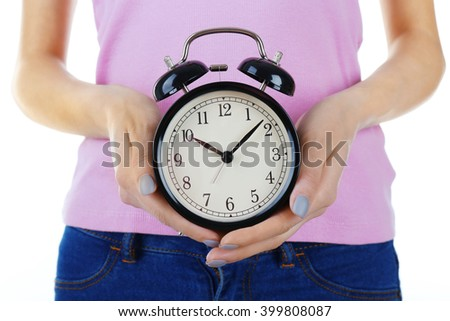 Woman holding vintage alarm clock in her hands. - stock photo
