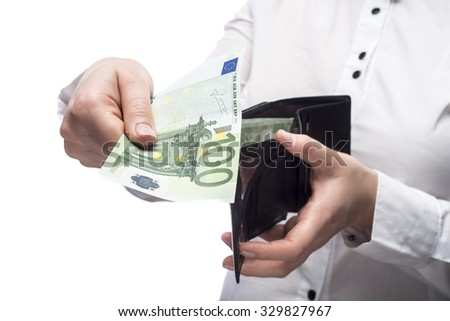 Woman holding wallet  - stock photo
