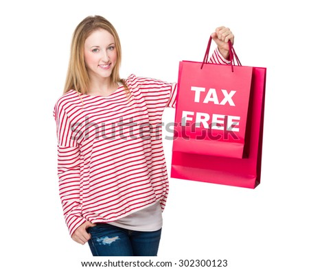 Woman holding with shopping bag and showing tax free - stock photo