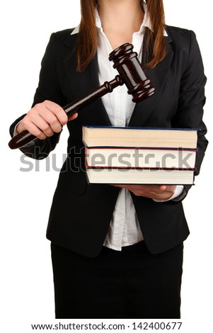 Woman holding wooden gavel and law books isolated on white - stock photo
