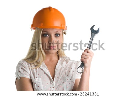 Woman holds a wrench on a white background - stock photo