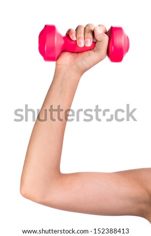 Woman holds dumbbells in her hand - stock photo