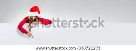 Woman holds hands: shows an empty white board - stock photo
