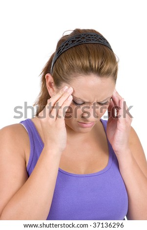 Woman holds her temples in pain caused by a migraine headache. - stock photo