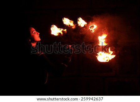 Woman holds in his hand the fire. - stock photo