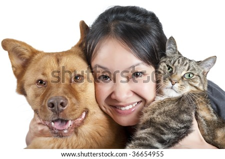 Woman hugging her dog and cat - stock photo