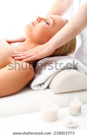 Woman in a beauty salon .Beauty salon, the woman at face massage . Attractive blonde woman in spa salon  - stock photo