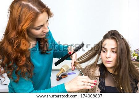 woman in a beauty salon doing hair - stock photo