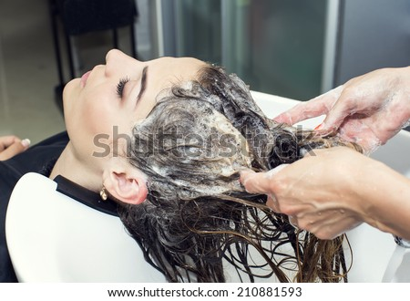 woman in a beauty salon doing hair - stock photo
