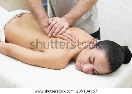 Woman in a beauty salon doing massage - stock photo
