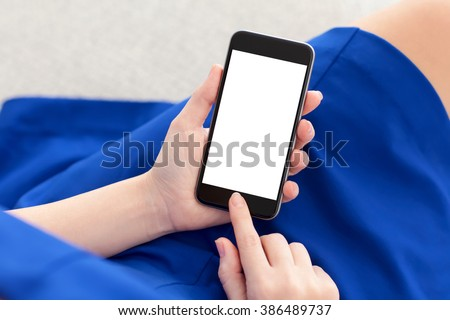 woman in a blue dress holding a phone with isolated screen - stock photo