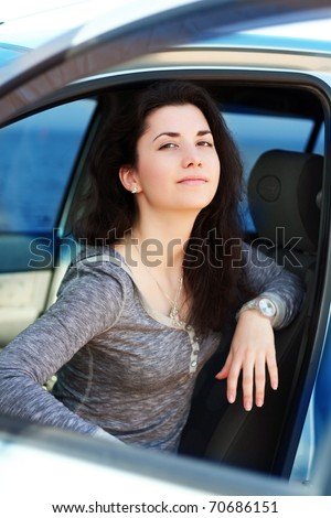 Woman in a car - stock photo