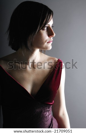 Woman in a classic pose on a gray background - stock photo