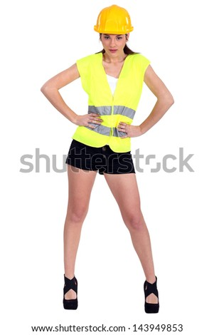 Woman in a hardhat and hotpants - stock photo