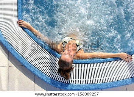 woman in a jacuzzi completely relaxed and enjoying the water - stock photo