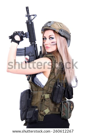 Woman in a military camouflage holding the assault rifle isolated over white background - stock photo