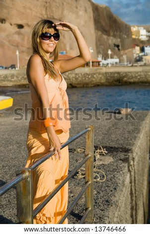 woman in a port looking for the horizon - stock photo