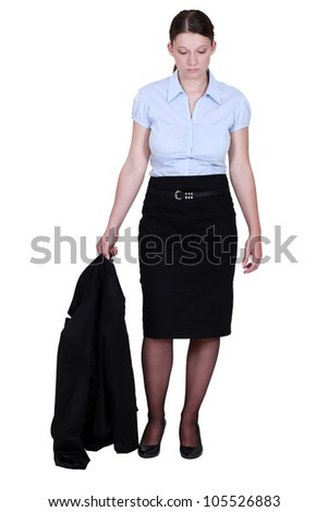 woman in a suit looking very sad - stock photo