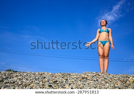woman in a swimsuit on the railway embankment - stock photo