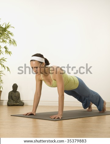 woman in a traditional yoga pose - stock photo