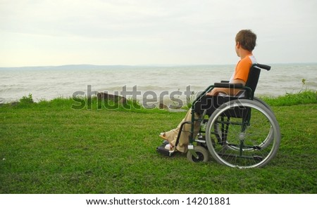 woman in a wheel chair - stock photo