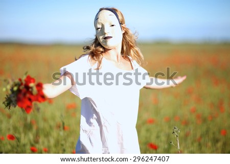 Woman in asian mask and white dress whirling outdoors - stock photo