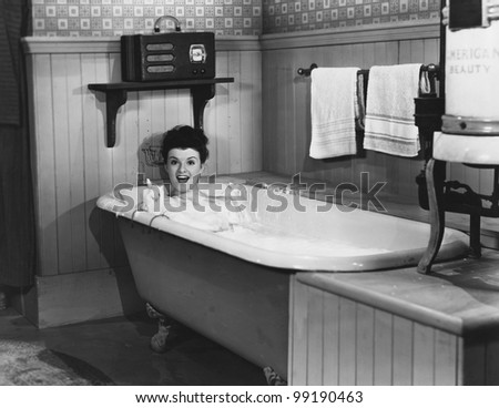 Woman in bathtub - stock photo
