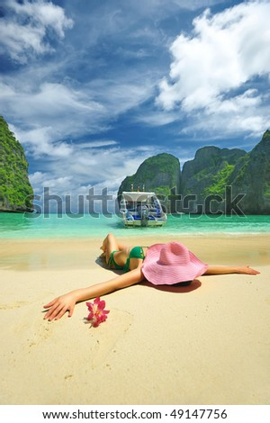 "Woman in beautiful lagoon at  Phi Phi Ley island, the exact place where ""The Beach"" movie was filmed - stock photo"