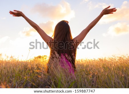 Woman in beautiful nature setting - stock photo