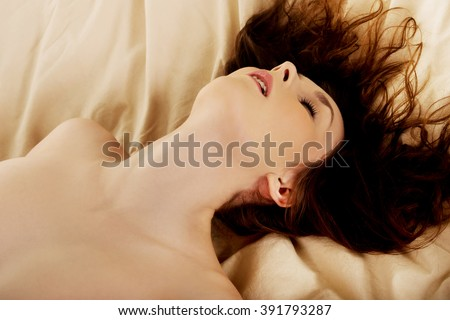 Woman in bed getting orgasm. - stock photo