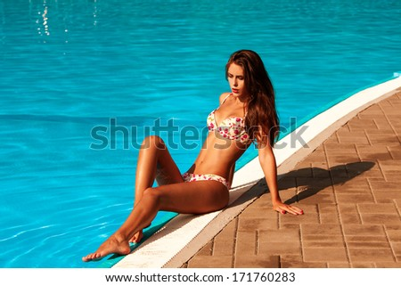woman in bikini by the  pool hot summer day - stock photo