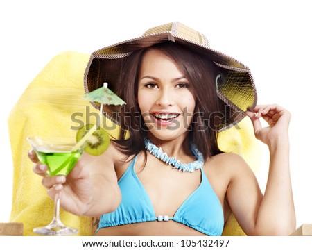 Woman in bikini drink juice through  straw. Isolated. - stock photo