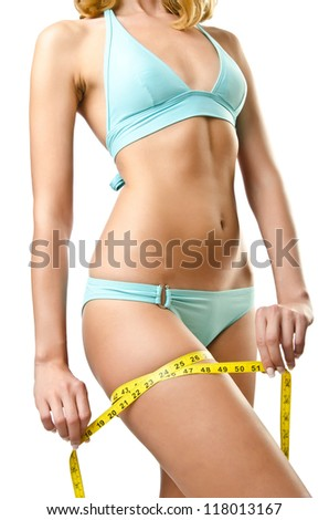 Woman in bikini in diet concept isolated on white - stock photo