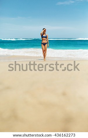 Woman In Bikini On Beach. Sexy Happy Girl With Fit Body, Healthy Sun Tan In Fashion Sport Swimwear Looking Far Away, Relaxing On Summer Vacations At Luxury Resort. Beautiful Female Enjoying Summertime - stock photo