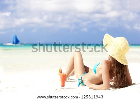 woman in bikini with fresh watermelon juice on tropical beach - stock photo