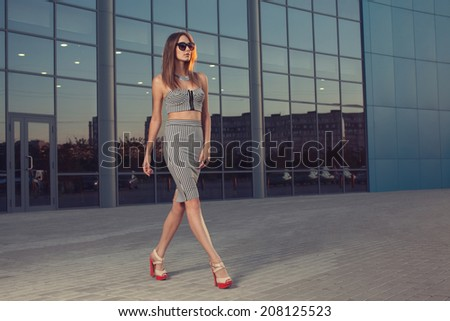 Woman in black and white striped dress - stock photo