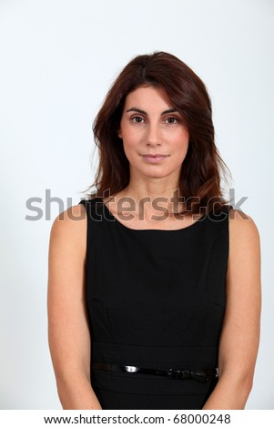 Woman in black dress looking at camera - stock photo