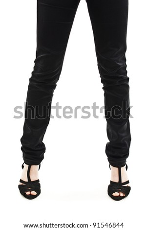 Woman in Black Jeans with Feet in Sandals - stock photo